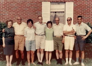 The eight siblings which comprised the second-generation standing in birth order. My dad (far right) is the only one still living at the time of this writing (2/2014).